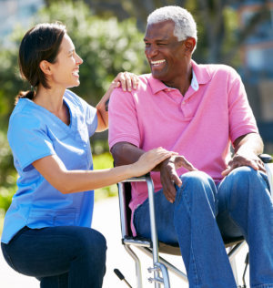 nurse and elderly man talking